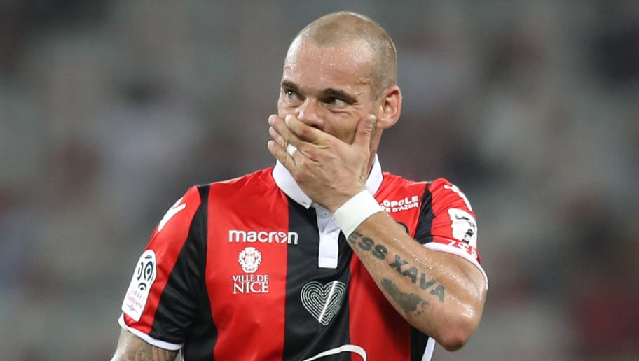 Nice's Dutch midfielder Wesley Sneijder reacts during the French L1 football match Nice vs Guingamp on August 19, 2017 at the 'Allianz Riviera' stadium in Nice, southeastern France.  / AFP PHOTO / VALERY HACHE        (Photo credit should read VALERY HACHE/AFP/Getty Images)
