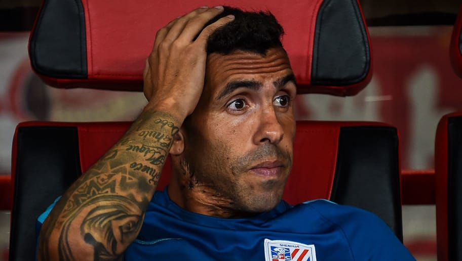 Shanghai Shenhua's Carlos Tevez looks on during the 2017 Chinese Super League football match between Shanghai East Asia (SIPG) FC and Shanghai Shenhua in Shanghai on September 16, 2017. / AFP PHOTO / CHANDAN KHANNA / China OUT / XGTY        (Photo credit should read CHANDAN KHANNA/AFP/Getty Images)