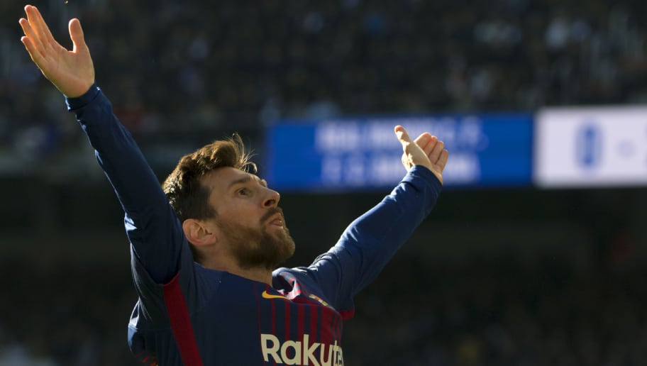 Barcelona's Argentinian forward Lionel Messi celebrates after scoring during the Spanish League 'Clasico' football match Real Madrid CF vs FC Barcelona at the Santiago Bernabeu stadium in Madrid on December 23, 2017.  / AFP PHOTO / CURTO DE LA TORRE        (Photo credit should read CURTO DE LA TORRE/AFP/Getty Images)