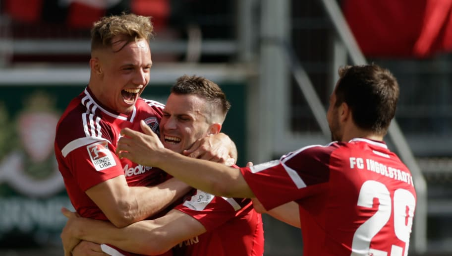 INGOLSTADT, GERMANY - MAY 06:  Sonny Kittel (L) of Ingolstadt celebrates with team mates after scoring his team's first goal during the Bundesliga match between FC Ingolstadt 04 and Bayer 04 Leverkusen at Audi Sportpark on May 6, 2017 in Ingolstadt, Germany.  (Photo by Johannes Simon/Bongarts/Getty Images)