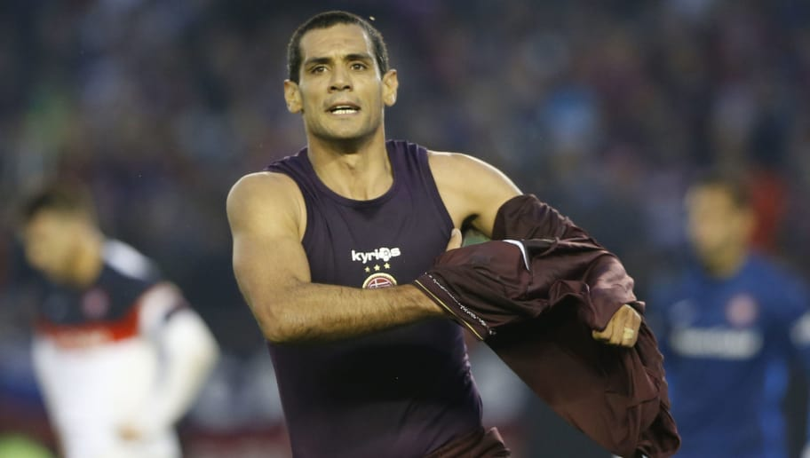 BUENOS AIRES, ARGENTINA - MAY 29:  Jose Sand of Lanus celebrates after scoring the third goal of his team during a final match between San Lorenzo and Lanus as part of Torneo Transicion 2016 at Monumental Stadium on May 29, 2016 in Buenos Aires, Argentina. (Photo by Gabriel Rossi/LatinContent/Getty Images)