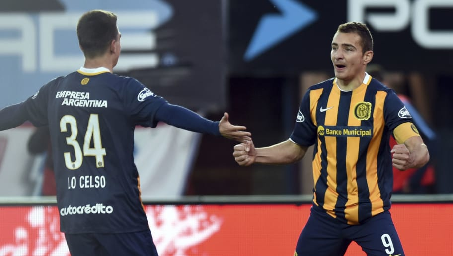 BUENOS AIRES, ARGENTINA - OCTOBER 03: Marco Ruben of Rosario Central celebrates with Giovani Lo Celso after scoring the first goal of his team through a penaly kick during a match between San Lorenzo and Rosario Central as part of 27th round of Torneo Primera Division 2015 at Pedro Bidegain Stadium on October 03, 2015 in Buenos Aires, Argentina. (Photo by Amilcar Orfali/LatinContent/Getty Images)
