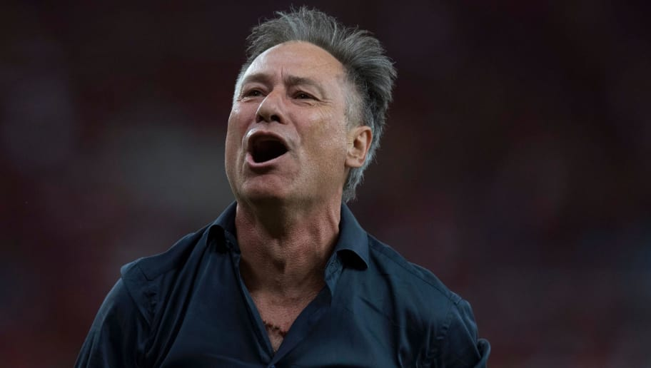 Argentina's Independiente coach Ariel Holan celebrates after his team wins the 2017 Sudamericana Cup championship at the Maracana stadium in Rio de Janeiro, Brazil, on December 13, 2017.  / AFP PHOTO / MAURO PIMENTEL        (Photo credit should read MAURO PIMENTEL/AFP/Getty Images)