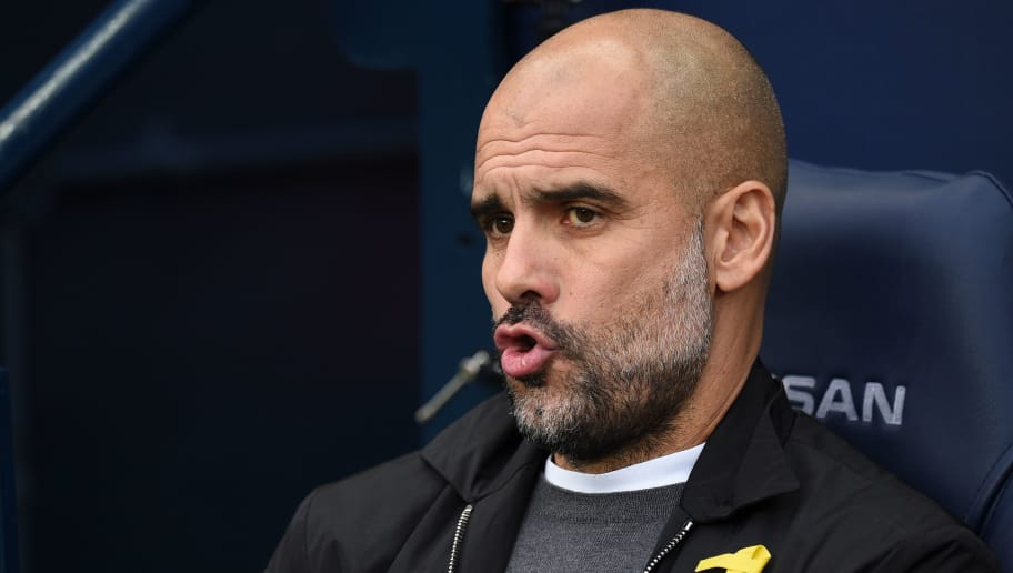 Manchester City's Spanish manager Pep Guardiola is seen ahead of the English Premier League football match between Manchester City and Bournemouth at the Etihad Stadium in Manchester, north west England, on December 23, 2017. / AFP PHOTO / Oli SCARFF / RESTRICTED TO EDITORIAL USE. No use with unauthorized audio, video, data, fixture lists, club/league logos or 'live' services. Online in-match use limited to 75 images, no video emulation. No use in betting, games or single club/league/player publications.  /         (Photo credit should read OLI SCARFF/AFP/Getty Images)