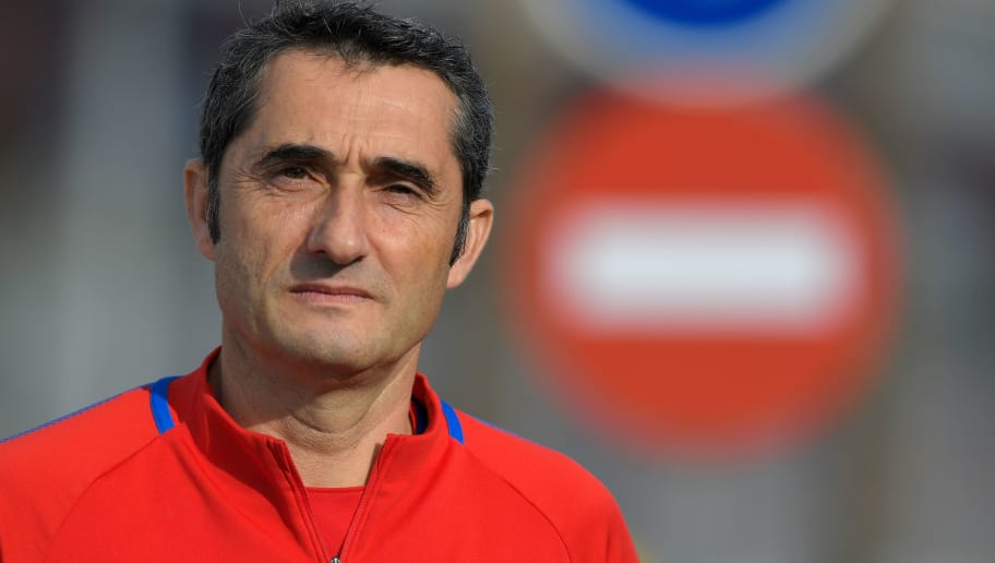 Barcelona's coach Ernesto Valverde arrives to give a press conference at the Sports Center FC Barcelona Joan Gamper in Sant Joan Despi, near Barcelona on December 22, 2017 on the eve of the Spanish League 'Clasico' football match Real Madrid CF vs FC Barcelona. / AFP PHOTO / LLUIS GENE        (Photo credit should read LLUIS GENE/AFP/Getty Images)