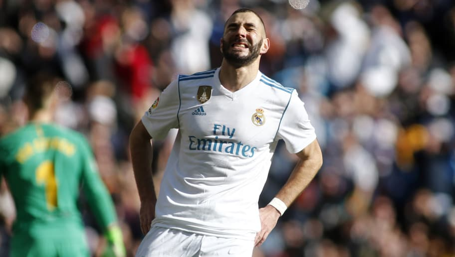 Real Madrid's French forward Karim Benzema reacts during the Spanish League 'Clasico' football match Real Madrid CF vs FC Barcelona at the Santiago Bernabeu stadium in Madrid on December 23, 2017.  / AFP PHOTO / OSCAR DEL POZO        (Photo credit should read OSCAR DEL POZO/AFP/Getty Images)
