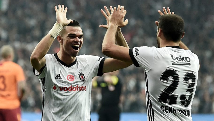 Besiktas' Turkish forward Cenk Tosun (R) celebrates with his teammate Pepe after scoring a goal during the Turkish Super Lig football match between Besiktas and Galatasaray on December 2, 2017 at Vodafone Park Stadium in Istanbul. / AFP PHOTO / OZAN KOSE        (Photo credit should read OZAN KOSE/AFP/Getty Images)