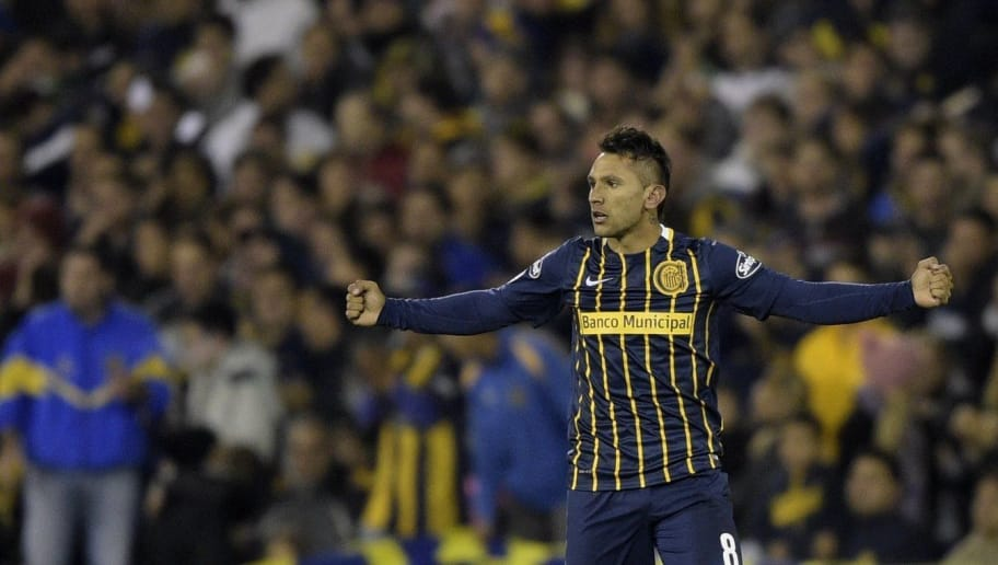 Argentina's Rosario Central midfielder Walter Montoya celebrates after scoring against Colombia's Atletico Nacional during their Copa Libertadores 2016 quarterfinals first leg football match at the 'Gigante de Arroyito' stadium in Rosario, Santa Fe, Argentina, on May 12, 2016. / AFP / JUAN MABROMATA        (Photo credit should read JUAN MABROMATA/AFP/Getty Images)