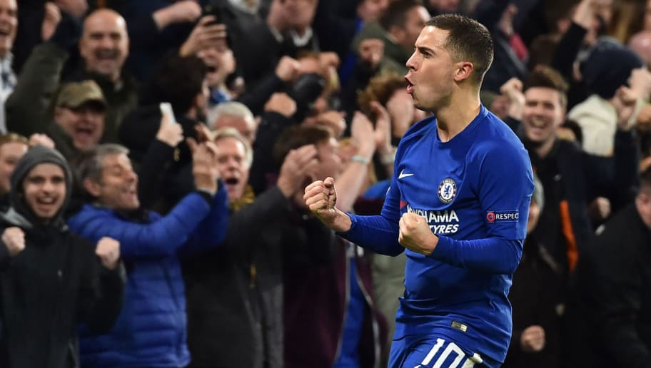 Chelsea's Belgian midfielder Eden Hazard celebrates an own goal by Atletico Madrid's Montenegrin defender Stefan Savic during a UEFA Champions League Group C football match between Chelsea and Atletico Madrid at Stamford Bridge in London on December 5, 2017. / AFP PHOTO / Glyn KIRK        (Photo credit should read GLYN KIRK/AFP/Getty Images)