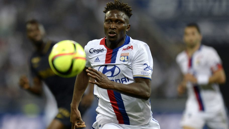 Lyon's French defender Mapou Yanga-Mbiwa runs with the ball during the French L1 football match between Olympique Lyonnais (OL) and Association sportive de Monaco (ASM) on May 7, 2016 at the Parc de l'Olympique Lyonnais in Decines-Charpieu, central eastern France.  / AFP / ROMAIN LAFABREGUE        (Photo credit should read ROMAIN LAFABREGUE/AFP/Getty Images)