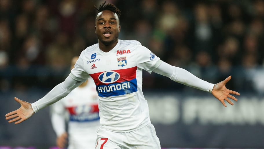 Lyon's French forward Maxwell Cornet celebrates after scoring a goal during the French L1 football match between Caen (SMC) and Lyon (OL) on December 3, 2017 at the Michel-d'Ornano stadium in Caen, northwestern France.  / AFP PHOTO / CHARLY TRIBALLEAU        (Photo credit should read CHARLY TRIBALLEAU/AFP/Getty Images)