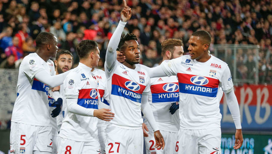Lyon's French forward Maxwell Cornet (C) celebrates with Lyon's Brazilian defender Marcelo (R) after scoring a goal during the French L1 football match between Caen (SMC) and Lyon (OL) on December 3, 2017 at the Michel-d'Ornano stadium in Caen, northwestern France.  / AFP PHOTO / CHARLY TRIBALLEAU        (Photo credit should read CHARLY TRIBALLEAU/AFP/Getty Images)