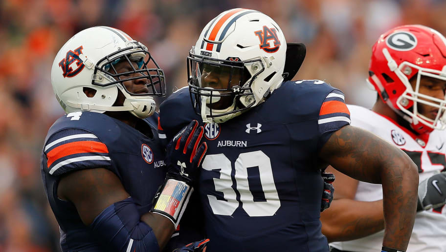 AUBURN, AL - NOVEMBER 11:  Tre' Williams #30 of the Auburn Tigers reacts after a defensive stop against the Georgia Bulldogs with Jeff Holland #4 at Jordan Hare Stadium on November 11, 2017 in Auburn, Alabama.  (Photo by Kevin C. Cox/Getty Images)