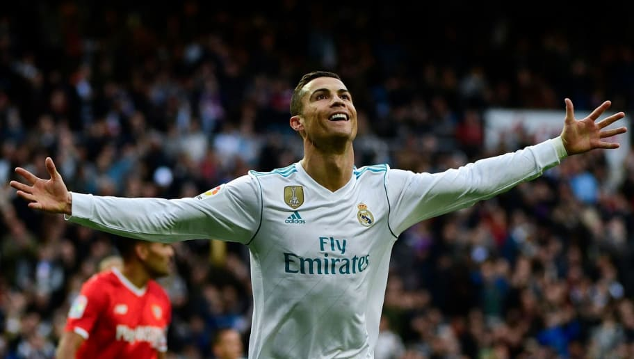 Real Madrid's Portuguese forward Cristiano Ronaldo celebrates after scoring a goal during the Spanish league football match between Real Madrid and Sevilla at the Santiago Bernabeu Stadium in Madrid on December 9, 2017. / AFP PHOTO / PIERRE-PHILIPPE MARCOU        (Photo credit should read PIERRE-PHILIPPE MARCOU/AFP/Getty Images)