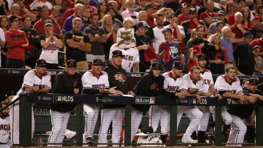 PHOENIX, AZ - OCTOBER 09: Members of the Arizona Diamondbacks watch the action in the ninth inning of the National League Divisional Series game three against the Los Angeles Dodgers at Chase Field on October 9, 2017 in Phoenix, Arizona.  (Photo by Christian Petersen/Getty Images)