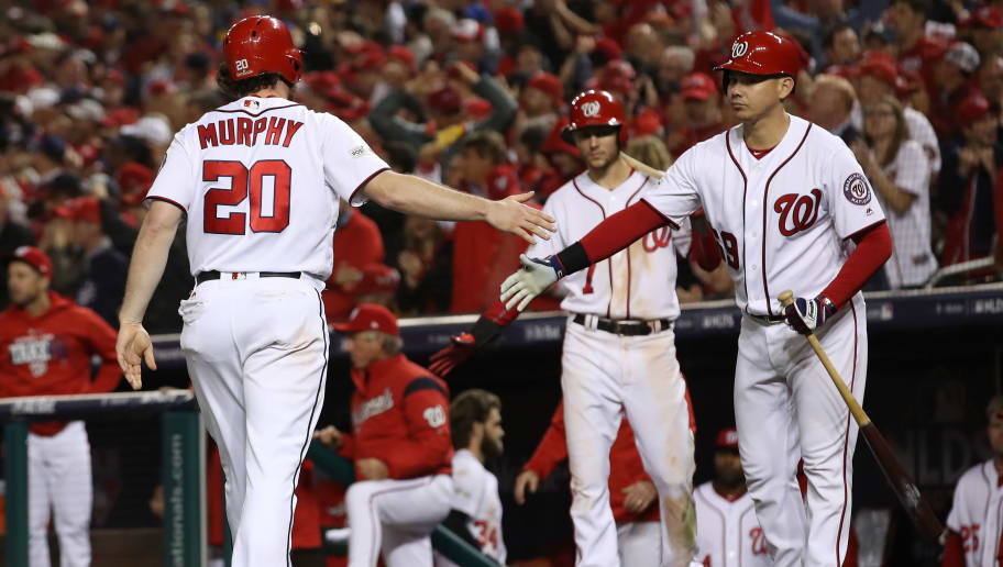 WASHINGTON, DC - OCTOBER 13:  Daniel Murphy #20 of the Washington Nationals reacts after scoring on an RBI single by Michael Taylor of the Washington Nationals against the Chicago Cubs during the eighth inning in game five of the National League Division Series at Nationals Park on October 13, 2017 in Washington, DC. (Photo by Win McNamee/Getty Images)