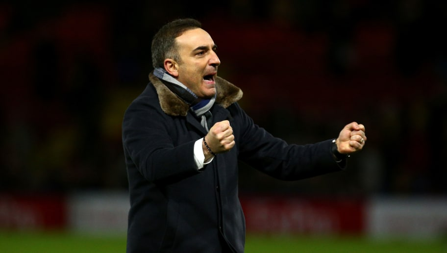 WATFORD, ENGLAND - DECEMBER 30:  Carlos Carvalhal, Manager of Swansea City celebrates after the Premier League match between Watford and Swansea City at Vicarage Road on December 30, 2017 in Watford, England.  (Photo by Charlie Crowhurst/Getty Images)