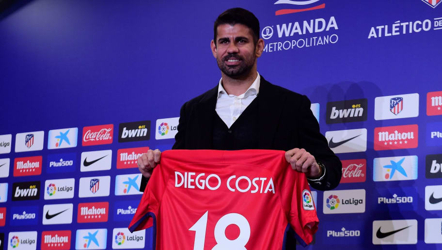 Atletico Madrid's Spanish forward Diego Costa poses with his jersey during his welcoming ceremony at the Wanda Metropolitan Stadium in Madrid on December 31, 2017. / AFP PHOTO / PIERRE-PHILIPPE MARCOU        (Photo credit should read PIERRE-PHILIPPE MARCOU/AFP/Getty Images)
