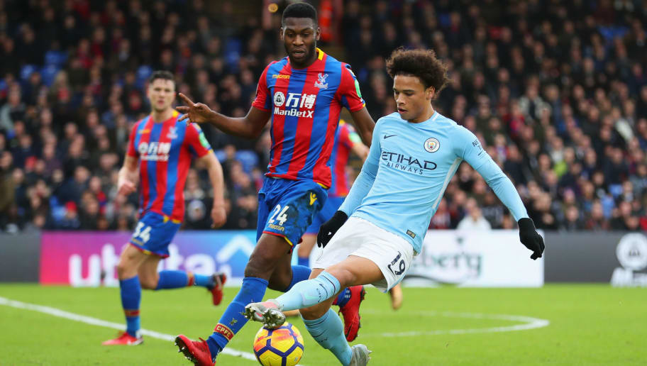 LONDON, ENGLAND - DECEMBER 31:  Leroy Sane of Manchester City is marshalled by Timothy Fosu-Mensah of Crystal Palace during the Premier League match between Crystal Palace and Manchester City at Selhurst Park on December 31, 2017 in London, England.  (Photo by Catherine Ivill/Getty Images)