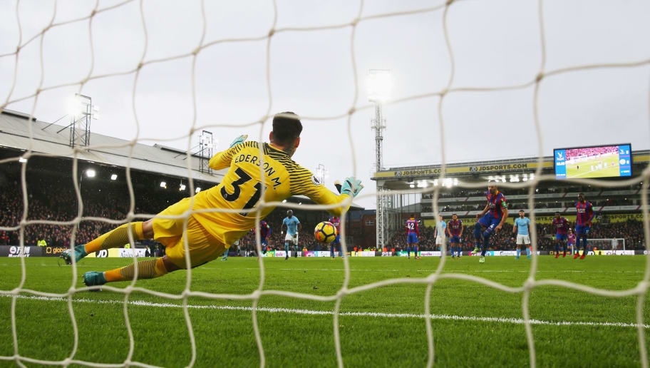 LONDON, ENGLAND - DECEMBER 31:  Luka Milivojevic of Crystal Palace has is penalty by Ederson of Manchester City during the Premier League match between Crystal Palace and Manchester City at Selhurst Park on December 31, 2017 in London, England.  (Photo by Catherine Ivill/Getty Images)
