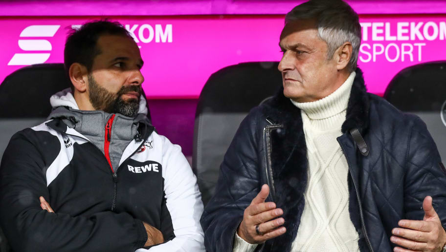 MUNICH, GERMANY - DECEMBER 13: Stefan Ruthenbeck Head Coach of 1. FC Koeln and Sport Director Armin Veh talk prior the Bundesliga match between FC Bayern Muenchen and 1. FC Koeln at Allianz Arena on December 13, 2017 in Munich, Germany.  (Photo by Alexander Hassenstein/Bongarts/Getty Images)