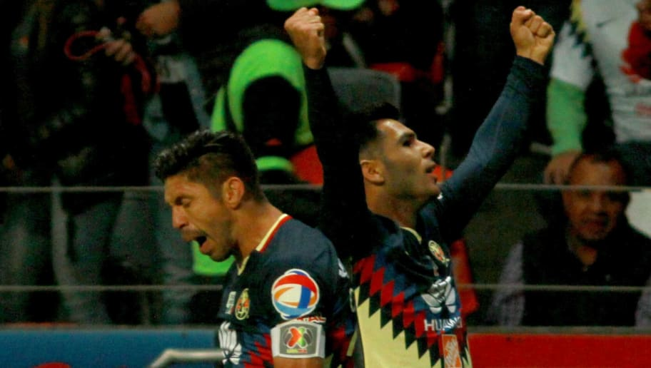 America's forward Silvio Romero (R) celebrates with teammate forward Oribe Peralta (L) after scoring the first goal against Toluca during their Mexican Apertura tournament football match at the Nemesio Diez stadium on September 30, 2017, in Toluca, Mexico. / AFP PHOTO / ROCIO VAZQUEZ        (Photo credit should read ROCIO VAZQUEZ/AFP/Getty Images)