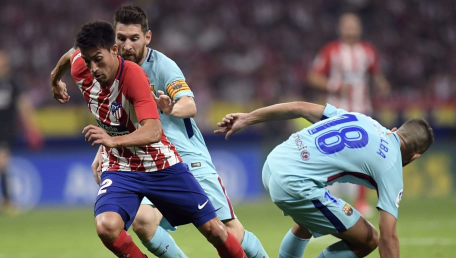 Barcelona's Argentinian forward Lionel Messi (2L) vies with Atletico Madrid's Argentinian midfielder Nico Gaitan (L) during the Spanish league football match Club Atletico de Madrid vs FC Barcelona at the Wanda Metropolitano stadium in Madrid on October 14, 2017. / AFP PHOTO / GABRIEL BOUYS        (Photo credit should read GABRIEL BOUYS/AFP/Getty Images)