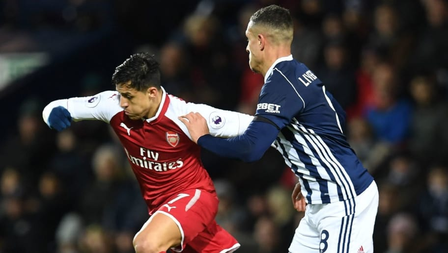 Arsenal's Chilean striker Alexis Sanchez (L) vies with West Bromwich Albion's English midfielder Jake Livermore during the English Premier League football match between West Bromwich Albion and Arsenal at The Hawthorns stadium in West Bromwich, central England, on December 31, 2017.  / AFP PHOTO / Paul ELLIS / RESTRICTED TO EDITORIAL USE. No use with unauthorized audio, video, data, fixture lists, club/league logos or 'live' services. Online in-match use limited to 75 images, no video emulation. No use in betting, games or single club/league/player publications.  /         (Photo credit should read PAUL ELLIS/AFP/Getty Images)