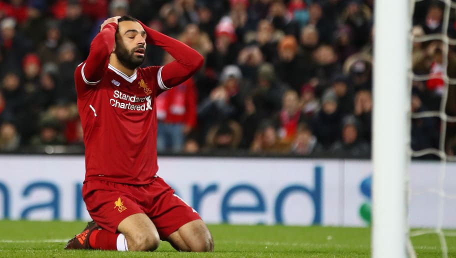 LIVERPOOL, ENGLAND - DECEMBER 13:  Mohamed Salah of Liverpool reacts after a near miss during the Premier League match between Liverpool and West Bromwich Albion at Anfield on December 13, 2017 in Liverpool, England.  (Photo by Clive Brunskill/Getty Images)