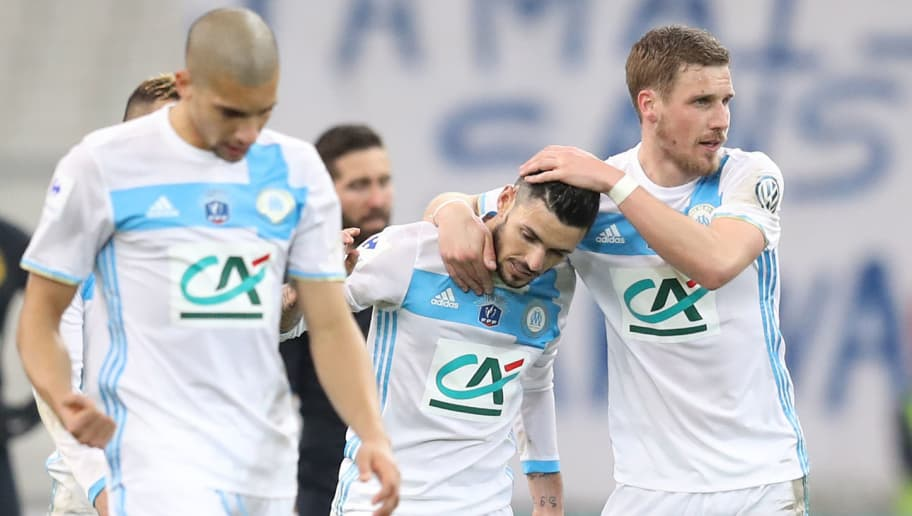 Olympique de Marseille's French midfielder Remy Cabella (C) celebrates with Marseille's midfielder Gregory Sertic (R) after scoring his team's third goal during the French Cup football match Marseille (OM) vs Monaco (ASM) on March 1, 2017 at the Velodrome stadium in Marseille, southern France.   / AFP PHOTO / VALERY HACHE        (Photo credit should read VALERY HACHE/AFP/Getty Images)