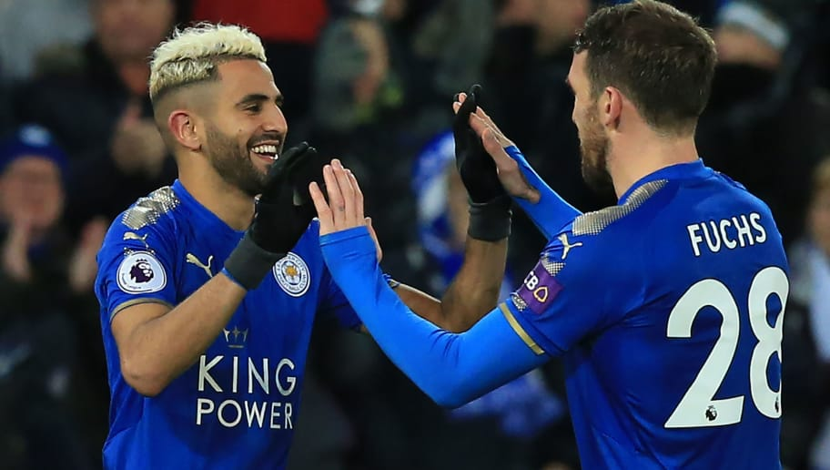 Leicester City's Algerian midfielder Riyad Mahrez (L) celebrates scoring the team's first goal with Leicester City's Austrian defender Christian Fuchs during the English Premier League football match between Leicester City and Huddersfield Town at King Power Stadium in Leicester, central England on January 1, 2018. / AFP PHOTO / Lindsey PARNABY / RESTRICTED TO EDITORIAL USE. No use with unauthorized audio, video, data, fixture lists, club/league logos or 'live' services. Online in-match use limited to 75 images, no video emulation. No use in betting, games or single club/league/player publications.  /         (Photo credit should read LINDSEY PARNABY/AFP/Getty Images)