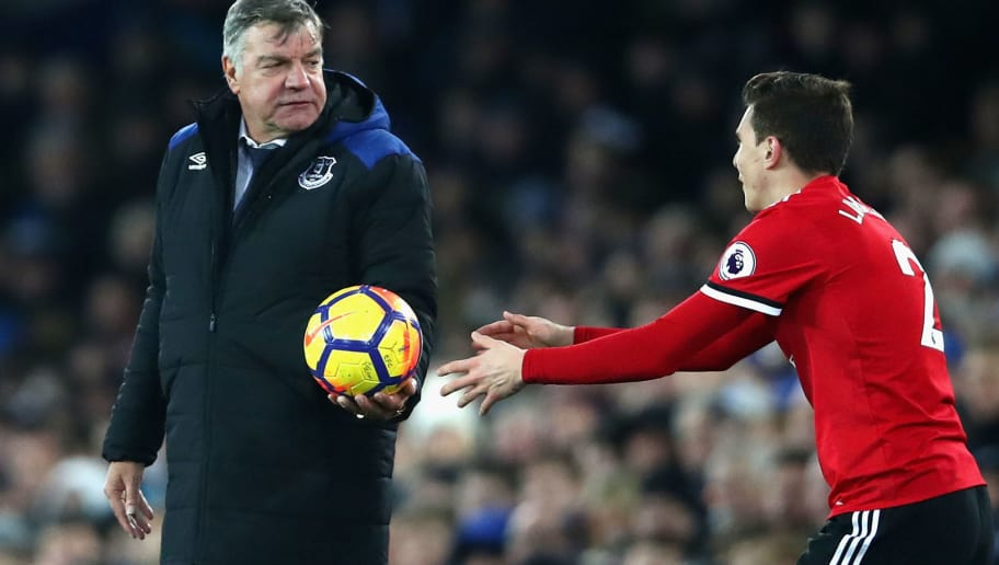 LIVERPOOL, ENGLAND - JANUARY 01:  Sam Allardyce, Manager of Everton passes the ball back to Victor Lindelof of Manchester United during the Premier League match between Everton and Manchester United at Goodison Park on January 1, 2018 in Liverpool, England.  (Photo by Clive Brunskill/Getty Images)