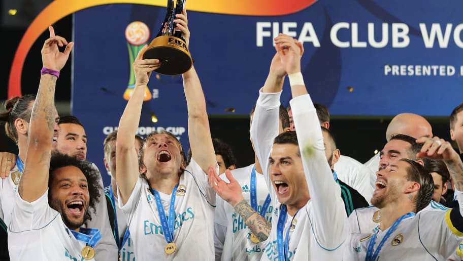 (Front L-R) Real Madrid's Marcelo, Luka Modric, Cristiano Ronaldo and Sergio Ramos celebrate with the FIFA Club World Cup trophy following their victory in the final football match against Gremio FBPA at the Zayed Sports City Stadium in Abu Dhabi on December 16, 2017. Real Madrid defeated Gremio 1-0 to lift the FIFA Club World Cup for the third time in their history. / AFP PHOTO / KARIM SAHIB        (Photo credit should read KARIM SAHIB/AFP/Getty Images)