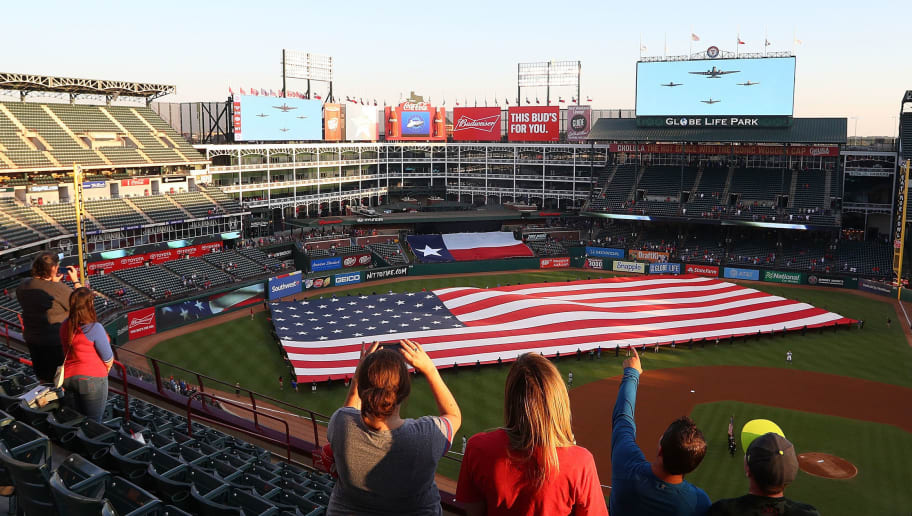 ARLINGTON, TX - SEPTEMBER 11:  Fans look up during a flyover by vintage aircraft in honor of  9/11 before the game between the Texas Rangers and Seattle Mariners at Globe Life Park in Arlington on September 11, 2017 in Arlington, Texas.  (Photo by Richard Rodriguez/Getty Images)
