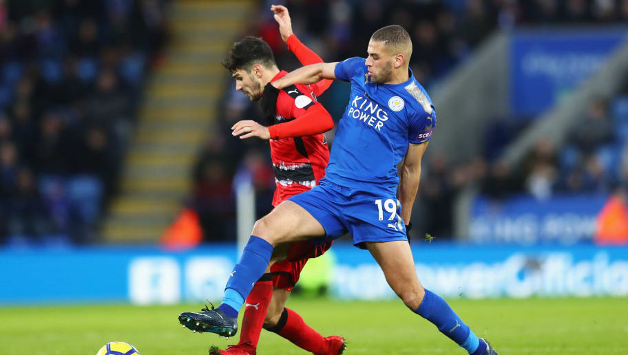 LEICESTER, ENGLAND - JANUARY 01:  Islam Slimani of Leicester City challenges Christopher Schindler of Huddersfield Town during the Premier League match between Leicester City and Huddersfield Town at The King Power Stadium on January 1, 2018 in Leicester, England.  (Photo by Clive Mason/Getty Images)