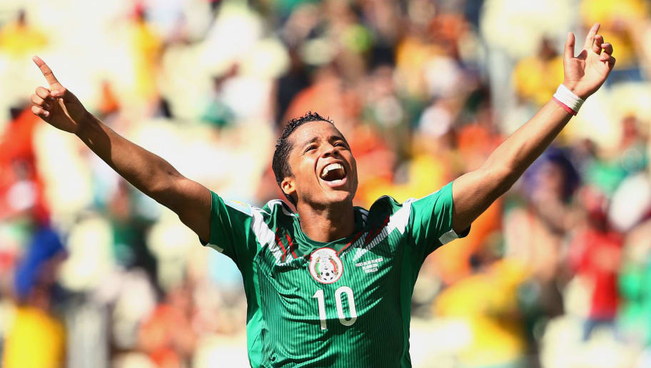 FORTALEZA, BRAZIL - JUNE 29:  Giovani dos Santos of Mexico celebrates scoring his team's first goal during the 2014 FIFA World Cup Brazil Round of 16 match between Netherlands and Mexico at Castelao on June 29, 2014 in Fortaleza, Brazil.  (Photo by Robert Cianflone/Getty Images)