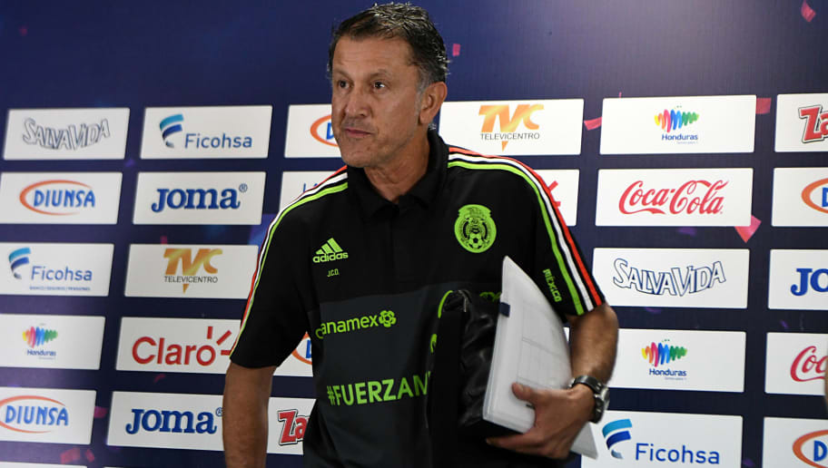Juan Carlos Osorio (L), the coach of Mexico's national football team, gets ready to take part in a press conference in San Pedro Sula, 180 km north of Tegucigalpa on October 9, 2017, one day ahead of their Russia World Cup 2018 eliminatory game against Honduras.  / AFP PHOTO / ORLANDO SIERRA        (Photo credit should read ORLANDO SIERRA/AFP/Getty Images)