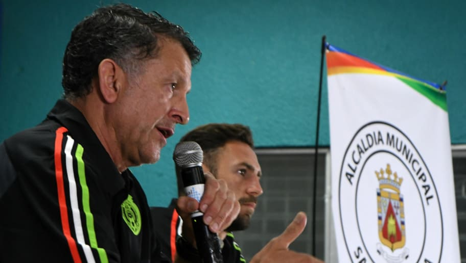 Juan Carlos Osorio (L), the coach of Mexico's national football team, and Mexican footballer Miguel Layun answer questions from the press in San Pedro Sula, 180 km north of Tegucigalpa on October 9, 2017, one day ahead of their Russia World Cup 2018 eliminatory game against Honduras.  / AFP PHOTO / ORLANDO SIERRA        (Photo credit should read ORLANDO SIERRA/AFP/Getty Images)