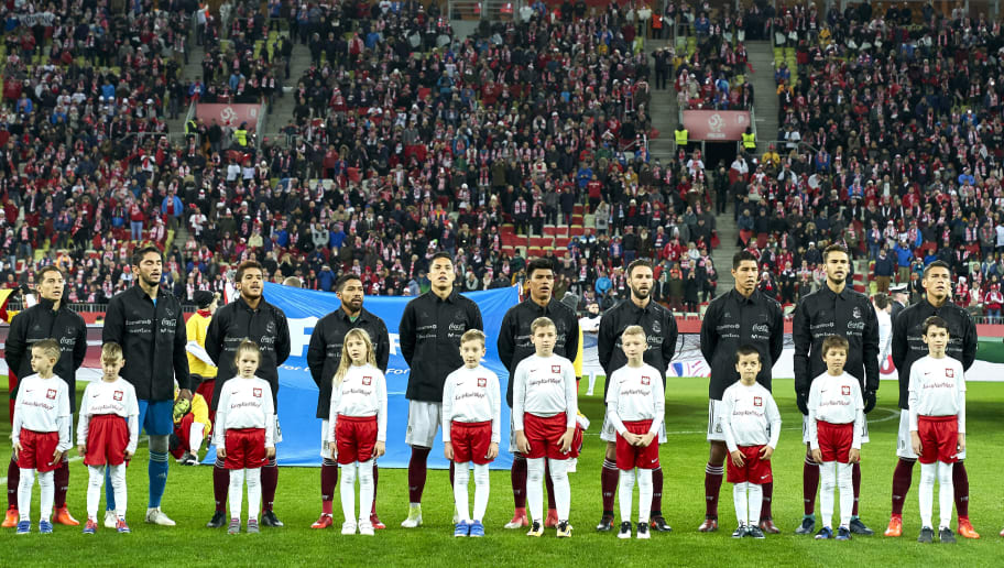 GDANSK, POLAND - NOVEMBER 13: Hugo Ayala and Raul Jimenez and Carlos Salcedo and Diego Reyes and Hector Moreno and goalkeeper Jose Jesus Corona and Jesus Gallardo and Andres Guardado and Jonathan dos Santos and Javier Aquino and Miguel Layun all of Mexico stand during national anthem before during the International Friendly match between Poland and Mexico at Energa Arena Stadium on November 13, 2017 in Gdansk, Poland. (Photo by Adam Nurkiewicz/Getty Images)