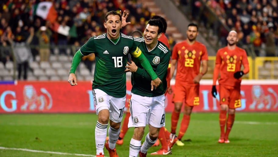 Mexico's midfielder Andres Guardado (L) celebrates with Mexico's midfielder Hirving Lozano (R) after scoring a goal during the international friendly football match between Belgium and Mexico at the King Baudouin Stadium in Brussels on November 10, 2017. / AFP PHOTO / DIRK WAEM        (Photo credit should read DIRK WAEM/AFP/Getty Images)