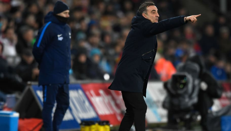SWANSEA, WALES - JANUARY 02:  Swansea manager Carlos Carvalhal reacts as Spurs manager Mauricio Pochettino looks on during the Premier League match between Swansea City and Tottenham Hotspur at Liberty Stadium on January 2, 2018 in Swansea, Wales.  (Photo by Stu Forster/Getty Images)