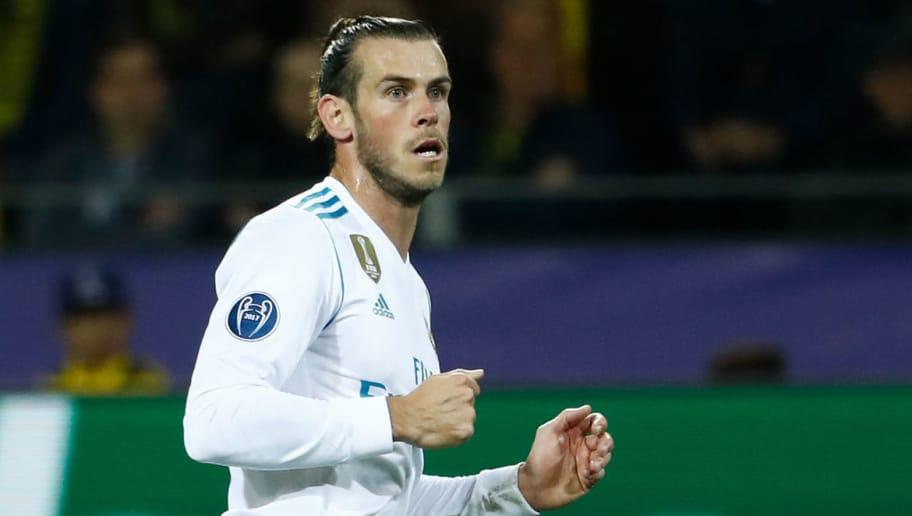 Real Madrid's forward from Wales Gareth Bale celebrates scoring the opening goal  during the UEFA Champions League Group H football match BVB Borussia Dortmund v Real Madrid in Dortmund, western Germany on September 26, 2017. / AFP PHOTO / Odd ANDERSEN        (Photo credit should read ODD ANDERSEN/AFP/Getty Images)