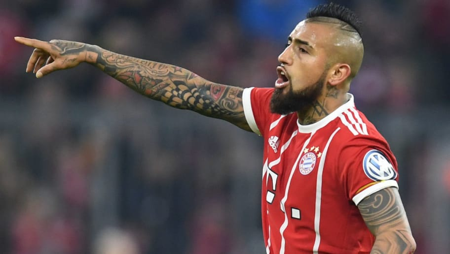 Bayern Munich's Chilean midfielder Arturo Vidal gestures during the German football Cup DFB Pokal round of sixteen match Bayern Munich vs Borussia Dortmund in Munich, southern Germany, on December 20, 2017.  / AFP PHOTO / CHRISTOF STACHE        (Photo credit should read CHRISTOF STACHE/AFP/Getty Images)