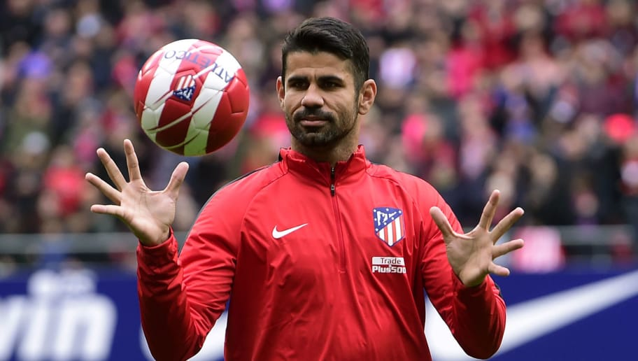 Atletico Madrid's Spanish forward Diego Costa catches a ball at the start of a training session following his welcoming ceremony at the Wanda Metropolitan Stadium in Madrid on December 31, 2017. / AFP PHOTO / PIERRE-PHILIPPE MARCOU        (Photo credit should read PIERRE-PHILIPPE MARCOU/AFP/Getty Images)