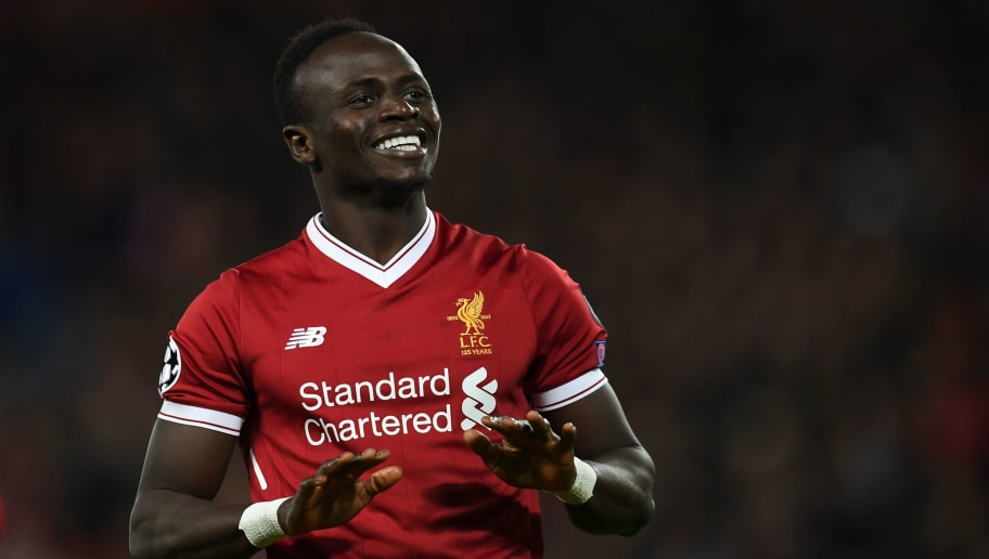Liverpool's Senegalese midfielder Sadio Mane celebrates scoring their fourth goal during the UEFA Champions League Group E football match between Liverpool and Spartak Moscow at Anfield in Liverpool, north-west England on December 6, 2017. / AFP PHOTO / Paul ELLIS        (Photo credit should read PAUL ELLIS/AFP/Getty Images)