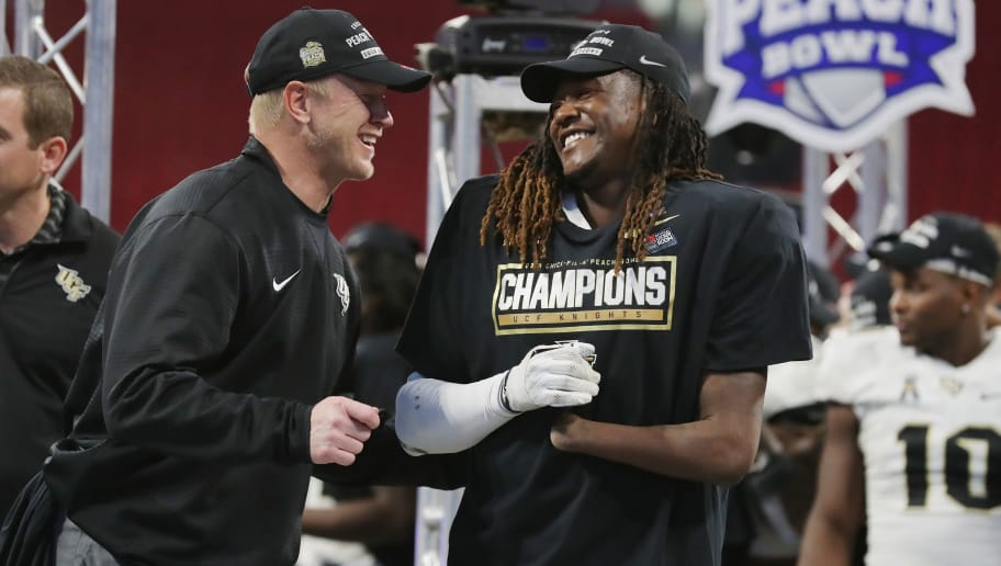 ATLANTA, GA - JANUARY 01:  Head coach Scott Frost of the UCF Knights celebrates with Shaquem Griffin #18 after defeating the Auburn Tigers 34-27 to win the Chick-fil-A Peach Bowl at Mercedes-Benz Stadium on January 1, 2018 in Atlanta, Georgia.  (Photo by Streeter Lecka/Getty Images)