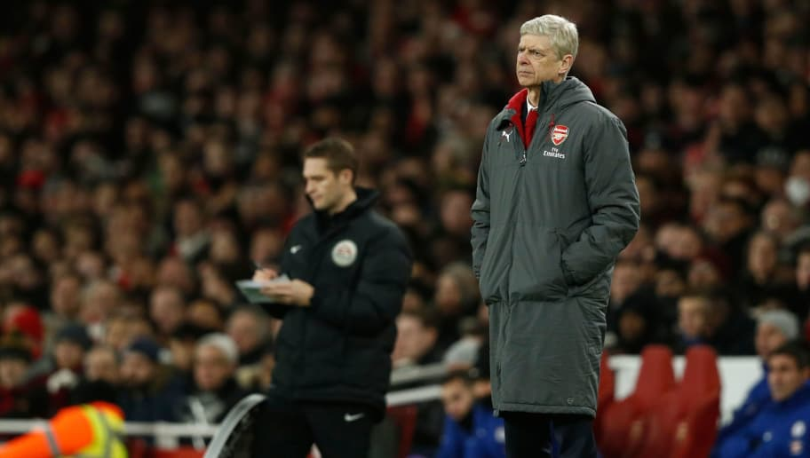 Arsenal's French manager Arsene Wenger looks on during the English Premier League football match between Arsenal and Chelsea at the Emirates Stadium in London on January 3, 2018.  / AFP PHOTO / Adrian DENNIS / RESTRICTED TO EDITORIAL USE. No use with unauthorized audio, video, data, fixture lists, club/league logos or 'live' services. Online in-match use limited to 75 images, no video emulation. No use in betting, games or single club/league/player publications.  /         (Photo credit should read ADRIAN DENNIS/AFP/Getty Images)