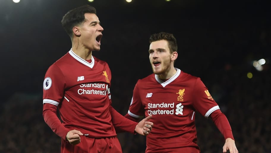 Liverpool's Brazilian midfielder Philippe Coutinho (L) celebrates scoring the English Premier League football match between Liverpool and Swansea City at Anfield in Liverpool, north west England on December 26, 2017. / AFP PHOTO / PAUL ELLIS / RESTRICTED TO EDITORIAL USE. No use with unauthorized audio, video, data, fixture lists, club/league logos or 'live' services. Online in-match use limited to 75 images, no video emulation. No use in betting, games or single club/league/player publications.  /         (Photo credit should read PAUL ELLIS/AFP/Getty Images)