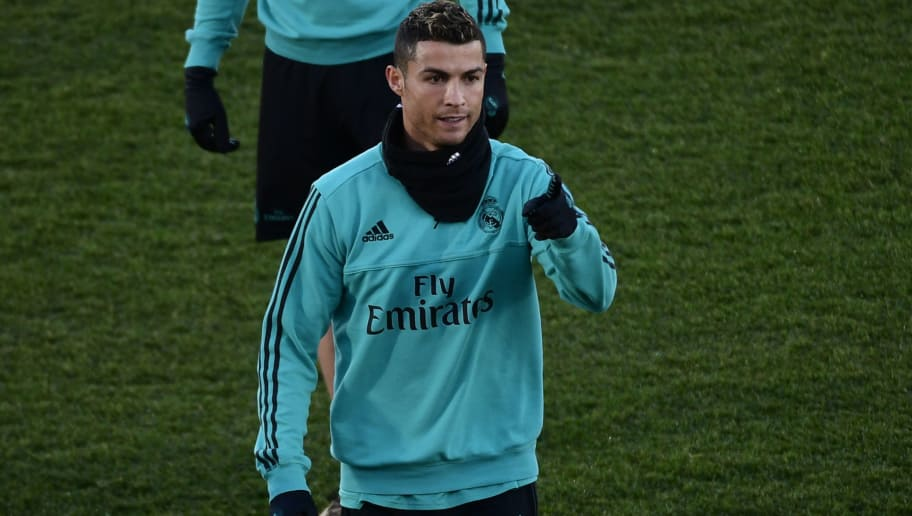Real Madrid's Portuguese forward Cristiano Ronaldo gestures during a training session in Madrid on December 30, 2017. / AFP PHOTO / PIERRE-PHILIPPE MARCOU        (Photo credit should read PIERRE-PHILIPPE MARCOU/AFP/Getty Images)