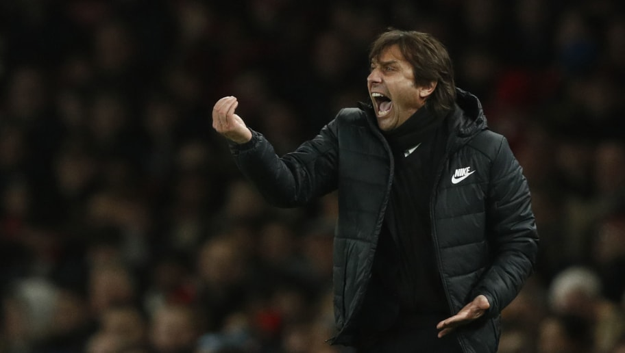 Chelsea's Italian head coach Antonio Conte gestures during the English Premier League football match between Arsenal and Chelsea at the Emirates Stadium in London on January 3, 2018.  / AFP PHOTO / Adrian DENNIS / RESTRICTED TO EDITORIAL USE. No use with unauthorized audio, video, data, fixture lists, club/league logos or 'live' services. Online in-match use limited to 75 images, no video emulation. No use in betting, games or single club/league/player publications.  /         (Photo credit should read ADRIAN DENNIS/AFP/Getty Images)